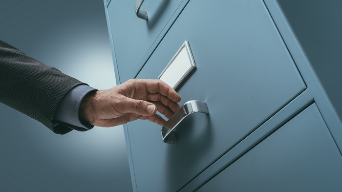 office-clerk-searching-files-in-the-filing-cabinet-p9j56mw